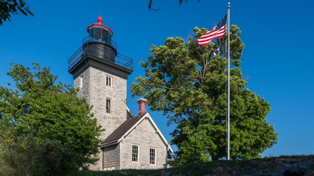 Thirty Mile Point Lighthouse and American flag on a nice spring day