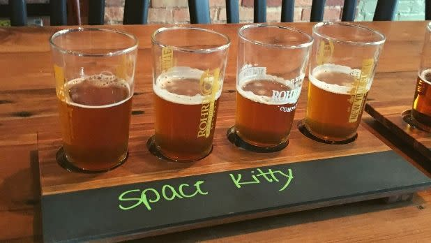 Flight of four beers on table at Rohrbach Brewing Company, Rochester, New York