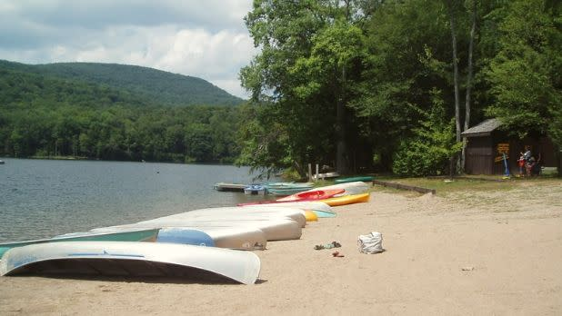 Canoes and kayaks on the beach at Little Pond State Campground