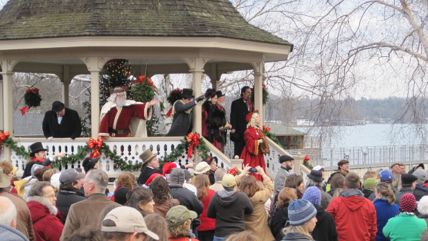 Santa and others in a gazebo for A Dickens Christmas celebration in Skaneateles