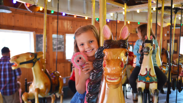 Child on Herschell Carrousel