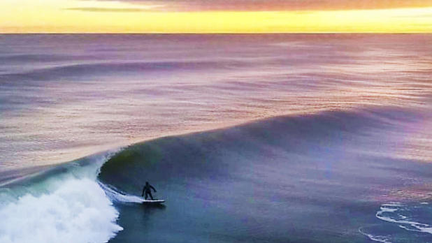 Surfing on Long beach Credit: Eric Schwab