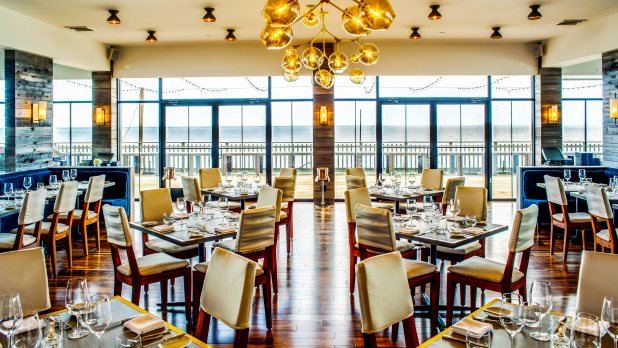 Scarpetta Beach at Gurney's features a sleek, open-concept dining room