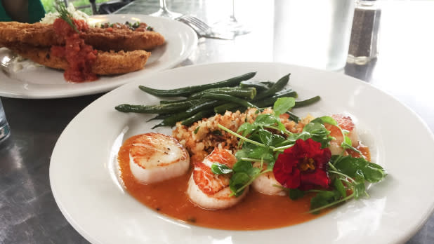 Scallops and vegetables on a plate at Stonecat Cafe in Hector, New York