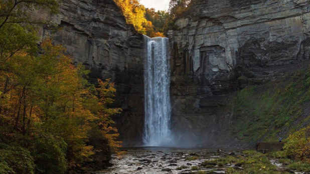 A photo of the Taughannock Falls State Park waterfall during the fall season