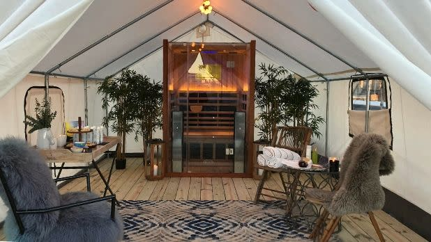 Interior tent with chairs and furniture at Terra Glamping on Long Island