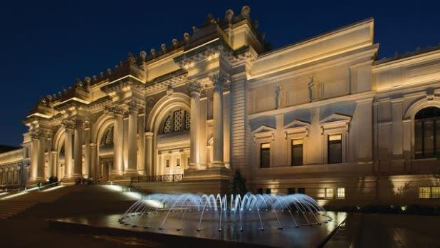 The Metropolitan Museum of Art at night with fountain