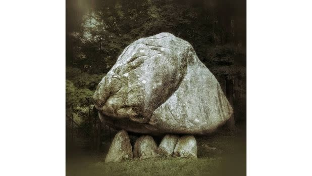 A giant boulder balancing on smaller boulders