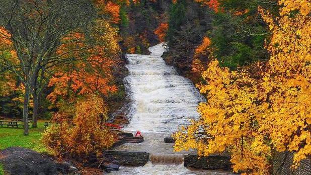 Buttermilk Falls waterfall on a fall day