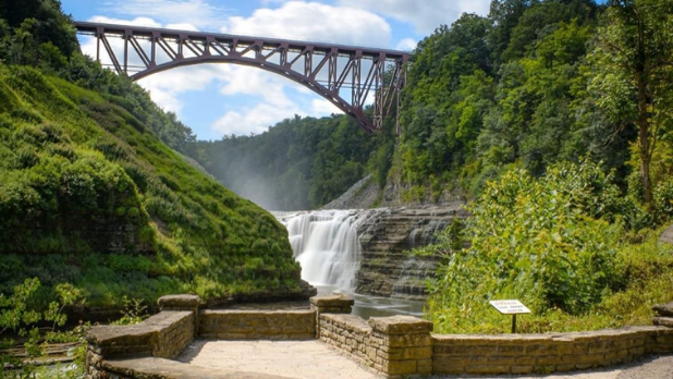 A photo of the Letchworth State Park during the summer with cascading waterways and green foliage