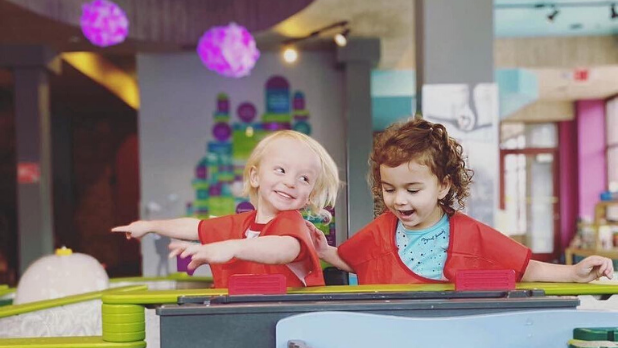 A photo of two little girls at the Children's Museum of Oswego