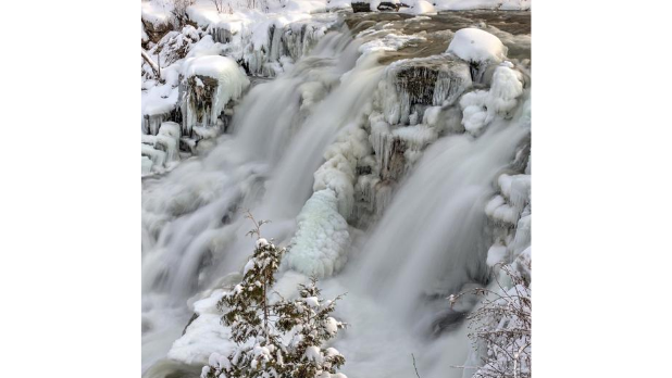Water flowing down Chittenango Falls on a winter day