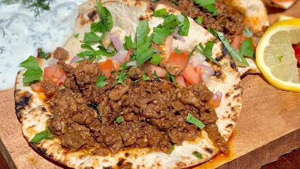 A taco with tomatoes and cilantro form the Tulip and the Rose