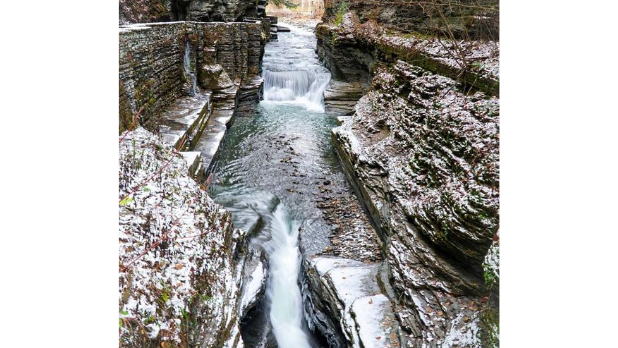 Water flowing down Robert Treman State Park Lower Falls on a winter day