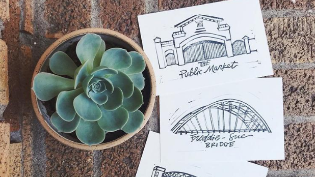 A succulent and three stickers, one for the Rochester Public Market and another for the Freddie-Sue Bridge