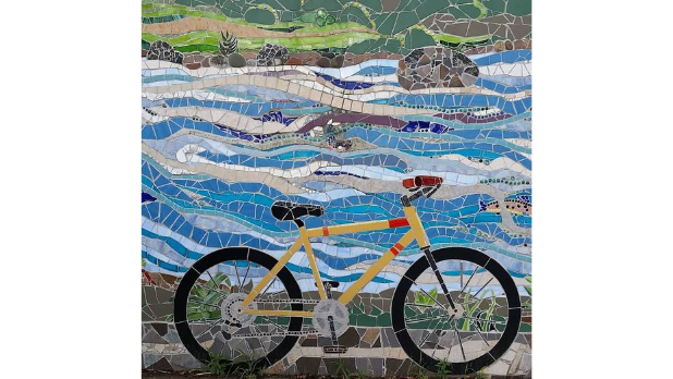 A mosaic of a bike in North Creek