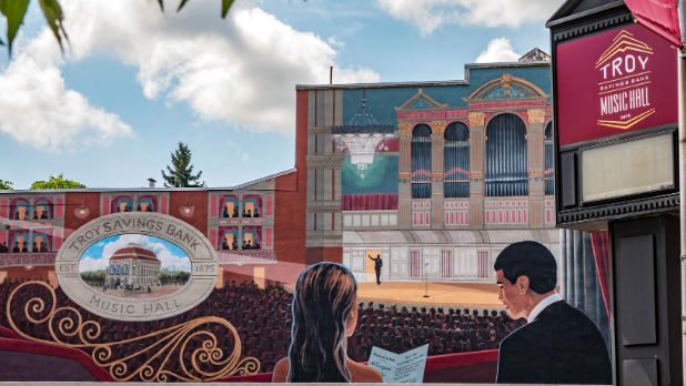 A mural of two people inside the Troy Savings Bank Music Hall