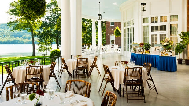 Dining on a porch on Lake Otsega at The Otesaga Resort in Cooperstown New York
