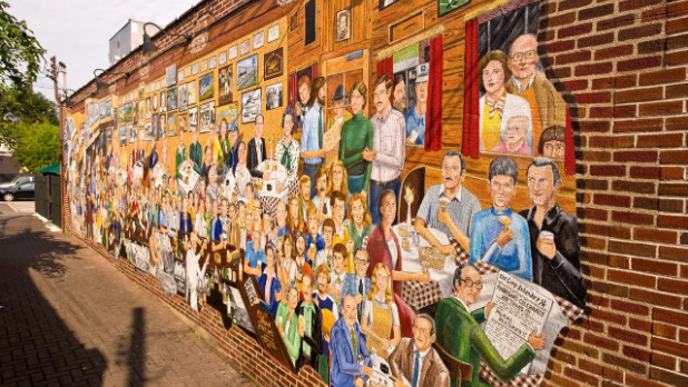 The mural on the side of Finnegan's in Long Island showing 140 people from the local area