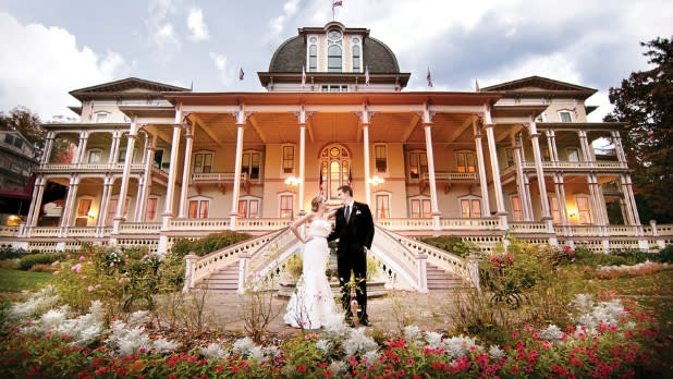 Bride and groom in front of Athenaeum Hotel of Chautauqua Institution in Chautauqua, New York