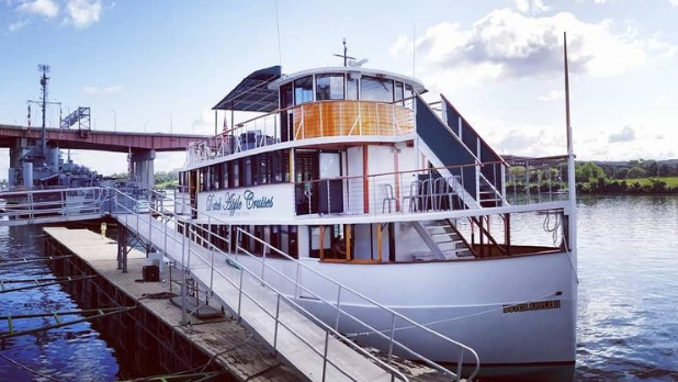 The exterior of the Dutch Apple Cruises boat on the water