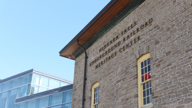 The exterior of the Niagara Falls Underground Railroad Heritage Center building and sign