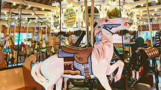 A white horse on the carousel at the Herschell Carrousel Factory Museum