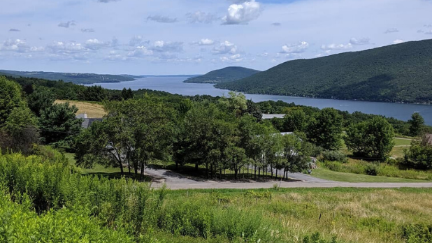 Rolling hills and mountains with trees and a view of the lake at Urbana State Forest