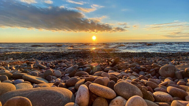 The rocky shore and sunset at Selkirk Shores State Park