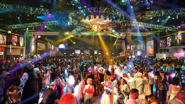 The crowd dancing at World's Largest Disco at the Buffalo Niagara Convention Center