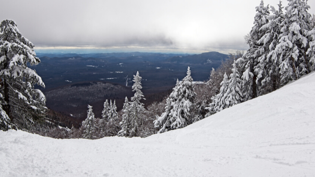 The snowy ski slope and trees at Gore Mountain in the Adirondacks