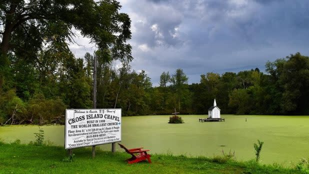 The world's smallest church on a lake on a cloudy day