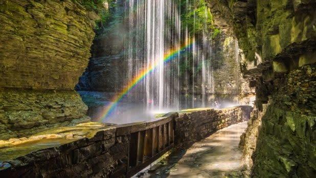 A rainbow seen through a waterfall at Watkins Glen State Park