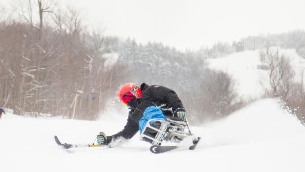An adaptive skier in action on a snow-covered slope on Whiteface Mountain