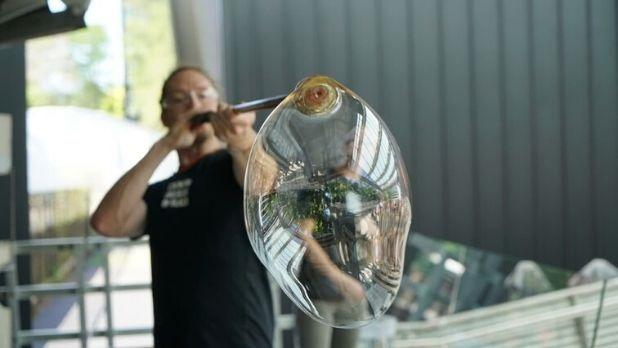 Man blowing glass at Corning Museum of Glass