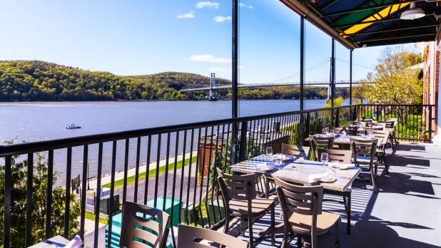 Outside patio of Shadow on the Hudson overlooking bridge