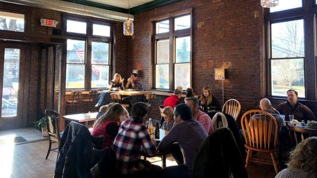 Patrons dine in the brick-walled interior of the Windham Local Public House