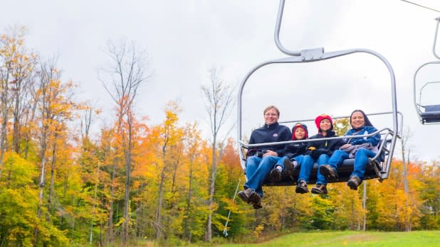 Family riding ski lift at Peek'n Peak Resort