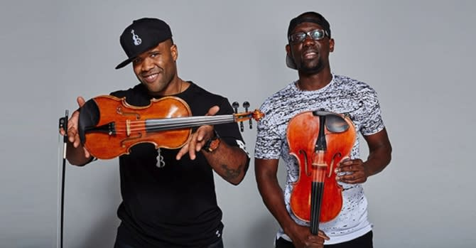 black violin band poses for photo