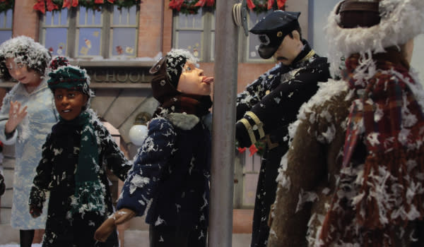 Flick Triple Dog Dare window display with boy's tongue stuck on a pole