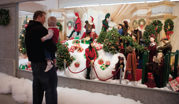 """Father and Son enjoy the Santa's Mountain window display from """"A Christmas Story"""""""