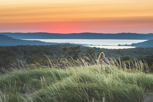 Woman Enjoying The Sunset At Sleeping Bear Dunes Overlook