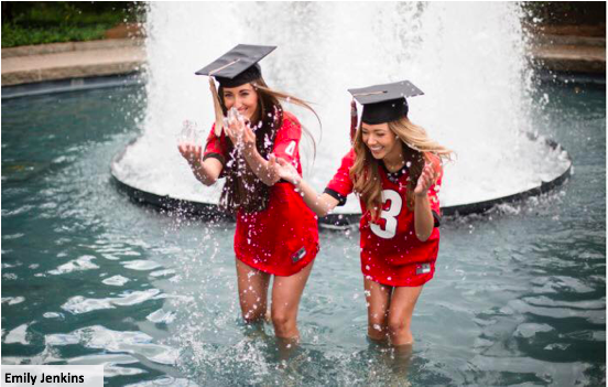 2 students wearing graduation caps in the UGA fountain