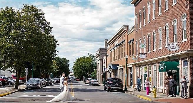 Bride walking in front of 300 Spring in Jeffersonville IN