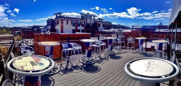 Rooftop patio with Red Bull tables at Saratoga City Tavern