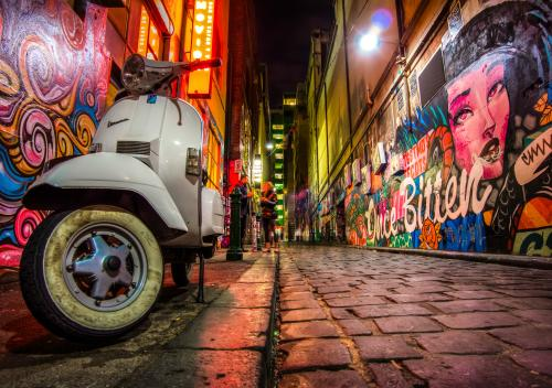 Laneway in Melbourne's City with colourful graffiti on the walls