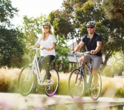 Woman & man biking in Oakland's Jack London District