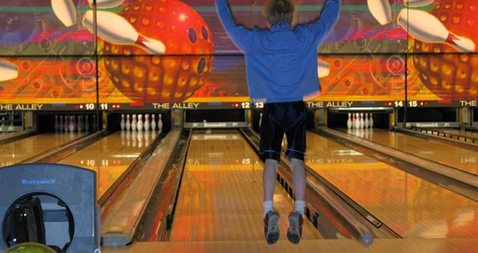 Celebrating after a strike at The Alley Bowling