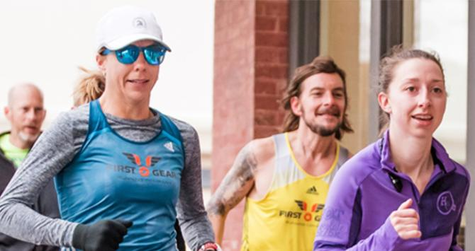 Chisholm Trail Marathon Register - runners in the last kick of the race in Wichita KS
