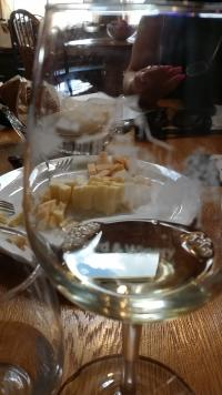 A glass of wine and appetizers at the Wine Shiloh Vineyard in WaKeeney, KS